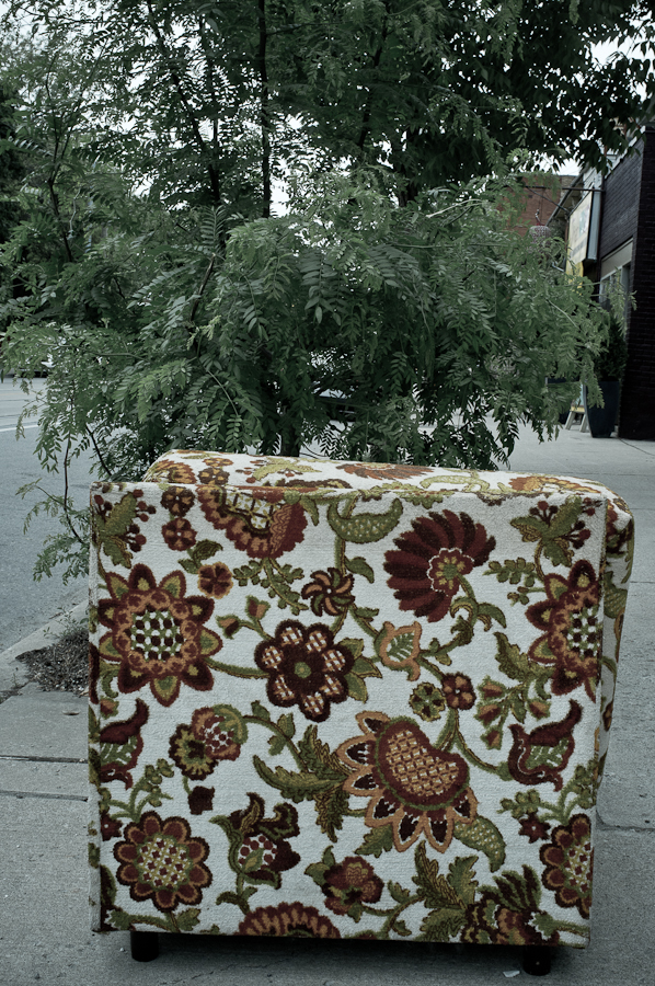 floral chair on sidewalk